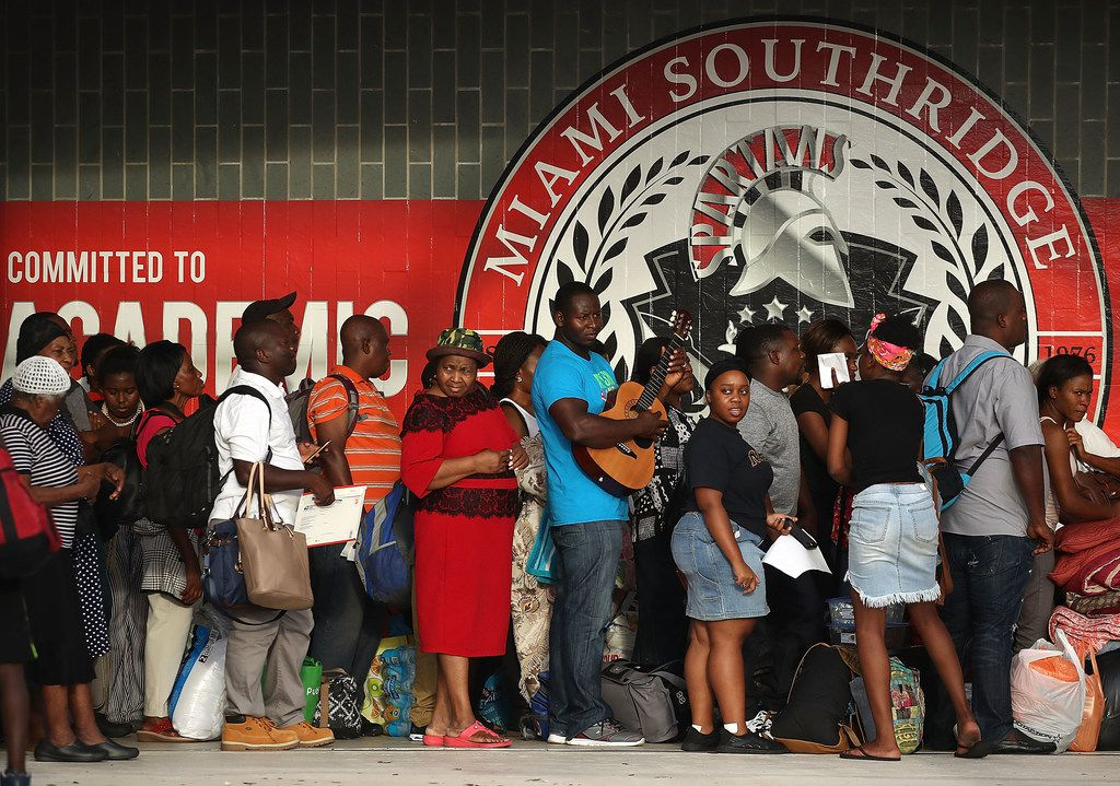 People wait to enter Miami Southridge High School, which is being used as a shelter for evacuees, as Hurricane Irma approached Friday in South Miami Heights, Fla.