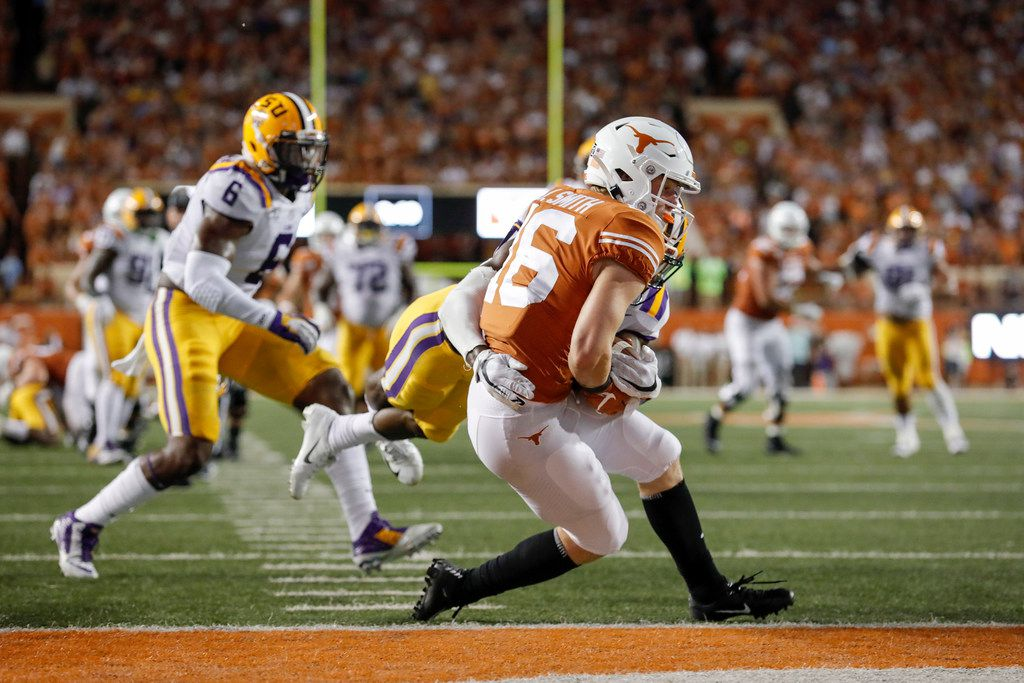 AUSTIN, TX - SEPTEMBER 07:  Jake Smith #16 of the Texas Longhorns catches a pass for a touchdown defended by John Emery Jr. #4 of the LSU Tigers in the third quarter at Darrell K Royal-Texas Memorial Stadium on September 7, 2019 in Austin, Texas.  (Photo by Tim Warner/Getty Images)