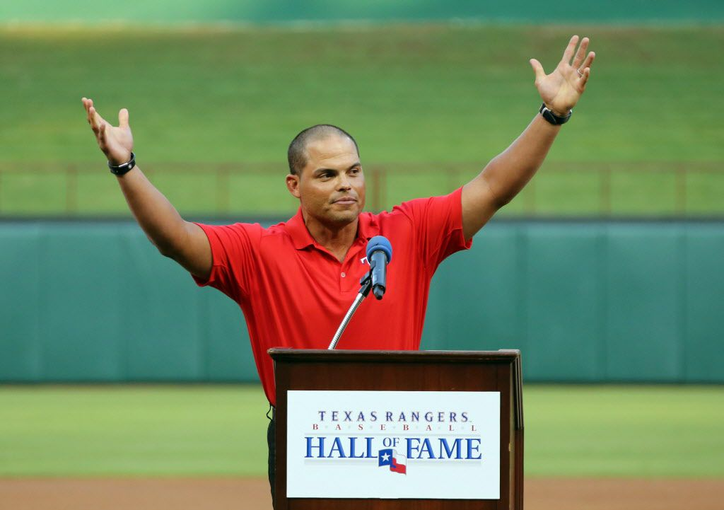 """Former Texas catcher Ivan """"Pudge"""" Rodriguez acknowledges the crowd a the end of his speech as he is inducted into the Texas Rangers Hall of Fame before the Baltimore Orioles vs. the Texas Rangers major league baseball game at Rangers Ballpark in Arlington on Saturday, July 20, 2013.  (Louis DeLuca/Dallas Morning News)"""