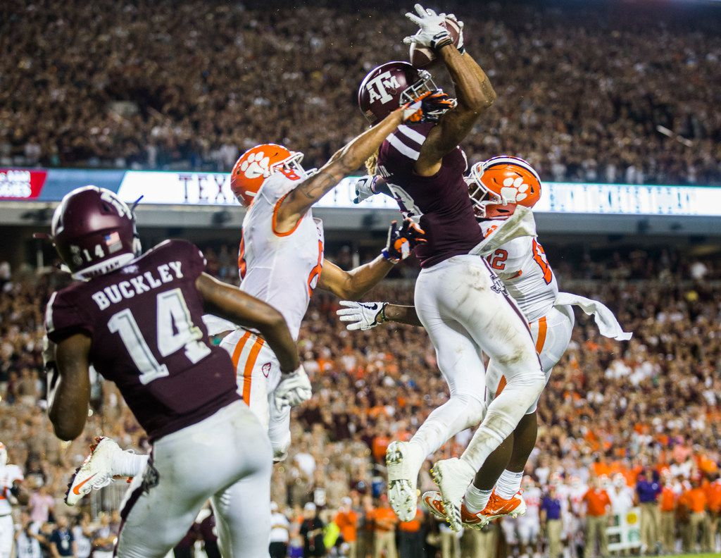 Texas A&M Aggies wide receiver Kendrick Rogers (13) catches a pass in the end zone for a touchdown during the third quarter of a college football game between the Clemson Tigers and the Texas A&M Aggies on Saturday, September 8, 2018 at Kyle Field in College Station, Texas. (Ashley Landis/The Dallas Morning News)