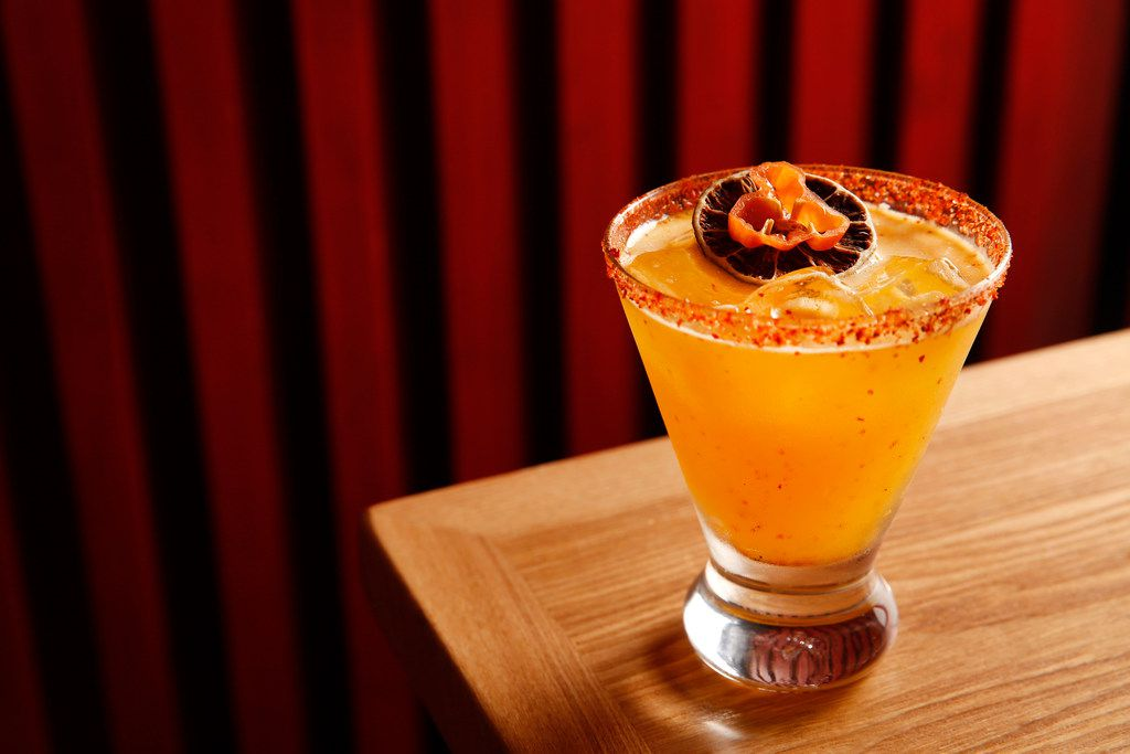"""The sicar, meaning """"smoky leaves"""" in Mayan, made with Banhez mescal, papaya puree, passionfruit syrup, fresh lime juice and habanero photographed at The Cedars Social in Dallas"""