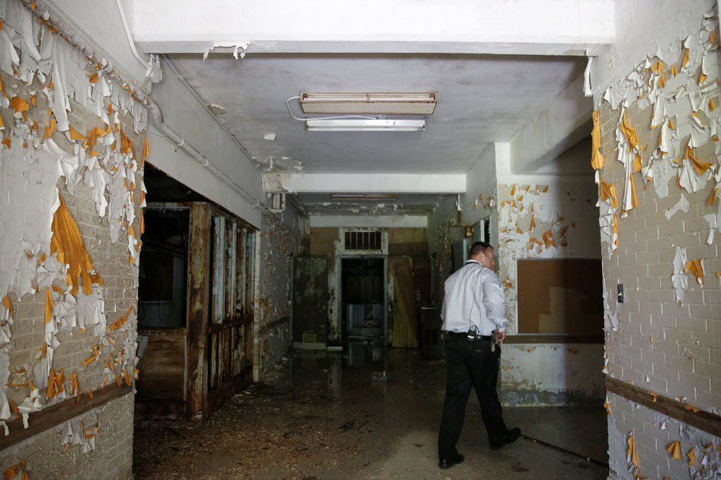 Matt Schoenfeld, plant maintenance manager, walks through the entrance to the former children's ward and school, unoccupied since 1985, during a tour of the Terrell State Hospital in Terrell, Texas on April 21, 2016.