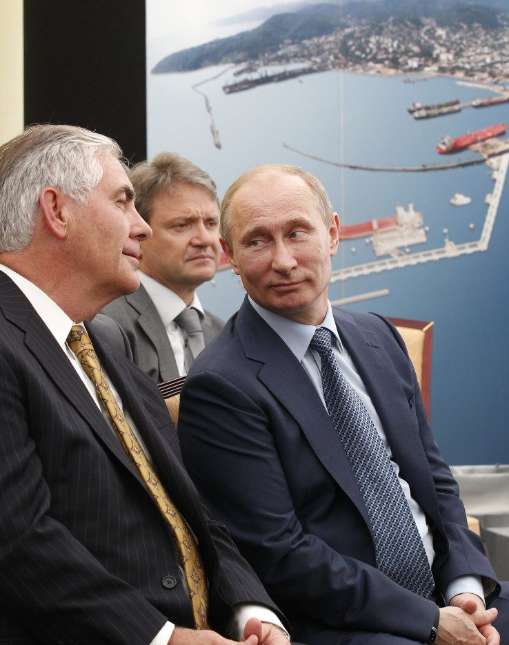 Russian President Vladimir Putin, right, and Exxon Mobil Corp. CEO Rex Tillerson, left, attend a signing ceremony of an agreement between state-controlled Russian oil company Rosneft and Exxon Mobil corporation at the Black Sea port of Tuapse, southern Russia, Friday, June 15, 2012. In the background is Krasnodar region governor Alexander Tkachev. (AP Photo/RIA-Novosti, Mikhail Klimentyev, Presidential Press Service) ORG XMIT: MOSB120