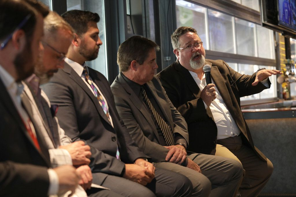 Neil Matkin (right), Collin College district president, and other guest speakers discuss the future of Collin County during a Dallas Morning News subscriber event at Legacy Hall's Unlawful Assembly Brewing in Plano.