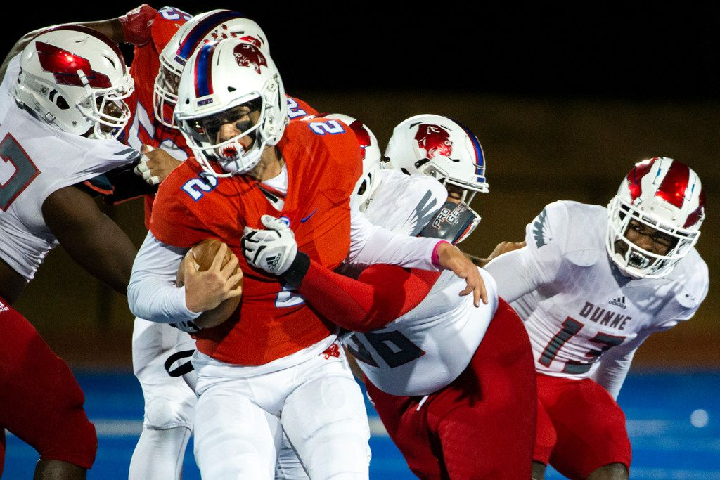 Parish Episcopal quarterback Preston Stone (2) gets taken down by Bishop Dunne defensive lineman Thomas Gort III (56) during the football game between Parish Episcopal High School and Bishop Dunne Catholic School at the Gloria H. Snyder Stadium in Farmers Branch, Texas, on Friday, Oct. 11, 2019. (Lynda M. Gonzalez/The Dallas Morning News)