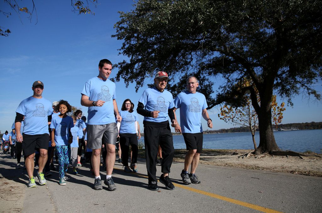 Orville Rogers, who is turning 100 years old, ran with his family near White Rock Lake in Dallas on Saturday. His family members ran a collective 100 miles that morning and finished the last mile with Orville.