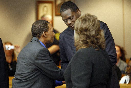 Johnnie Lindsey shakes hands with then-Dallas County District Attorney Craig Watkins, after Lindsey was declared a free man in 2008.