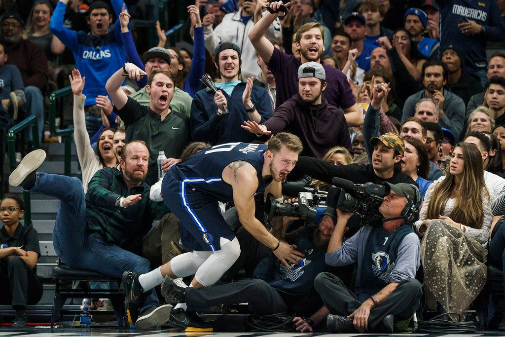 Dallas Mavericks guard Luka Doncic tumbles into the seats after making a shot during the second half of an NBA basketball game against the New York Knicks at American Airlines Center on Friday, Nov. 8, 2019, in Dallas. (Smiley N. Pool/The Dallas Morning News)