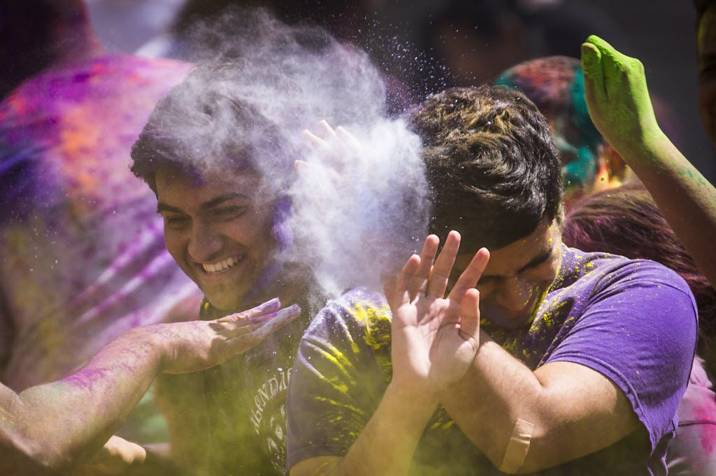 Celebrants are doused with colored powder during festivities celebrating the Hindu holiday of Holi at the D/FW Hindu Temple in Irving.