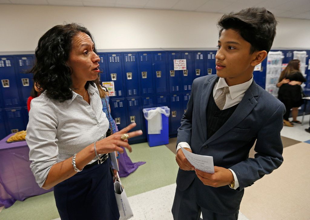 "Elizabeth ""Liz"" Cedillo-Pereira (left), Director of Office of Welcoming Communities and Immigrant Affairs at City of Dallas, talks with student Mohamad Faizal, a 13-year-old from Myanmar, during the EAGLE Scholars University Skill Showcase event at Sam Tasby Middle School in Dallas, Thursday, July 20, 2017."