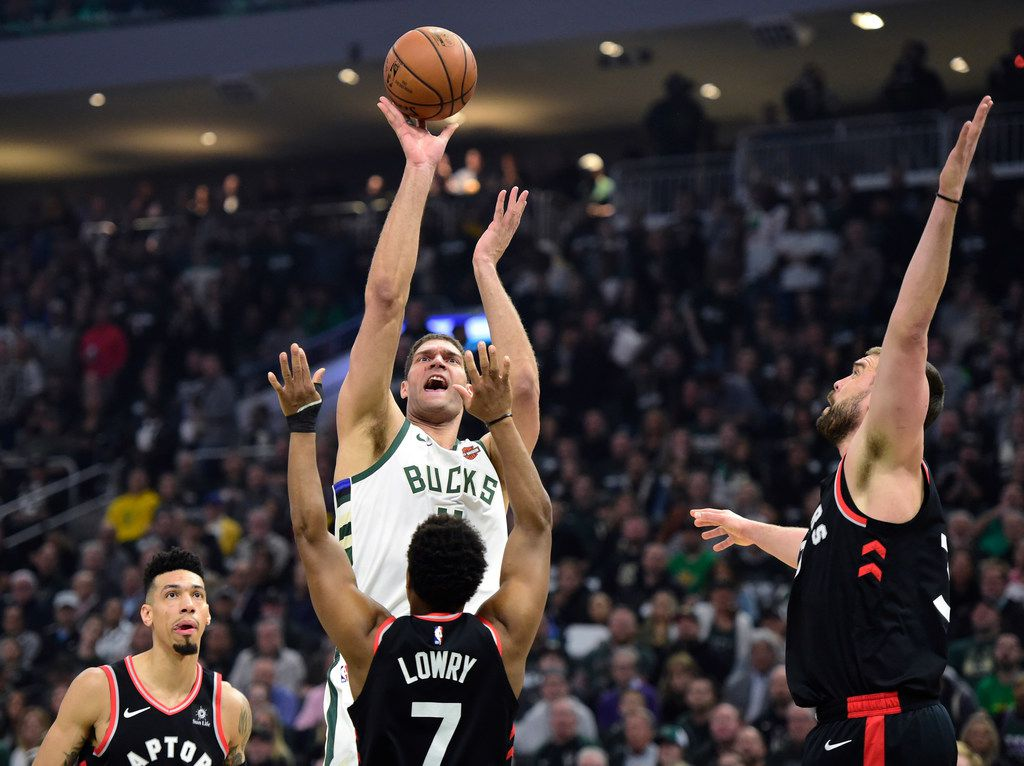 Milwaukee Bucks center Brook Lopez (11) shoots over Toronto Raptors guard Kyle Lowry (7) during the first half of Game 2 of the Eastern Conference finals on Friday, May 17, 2019, in Milwaukee. (Frank Gunn/The Canadian Press via AP)