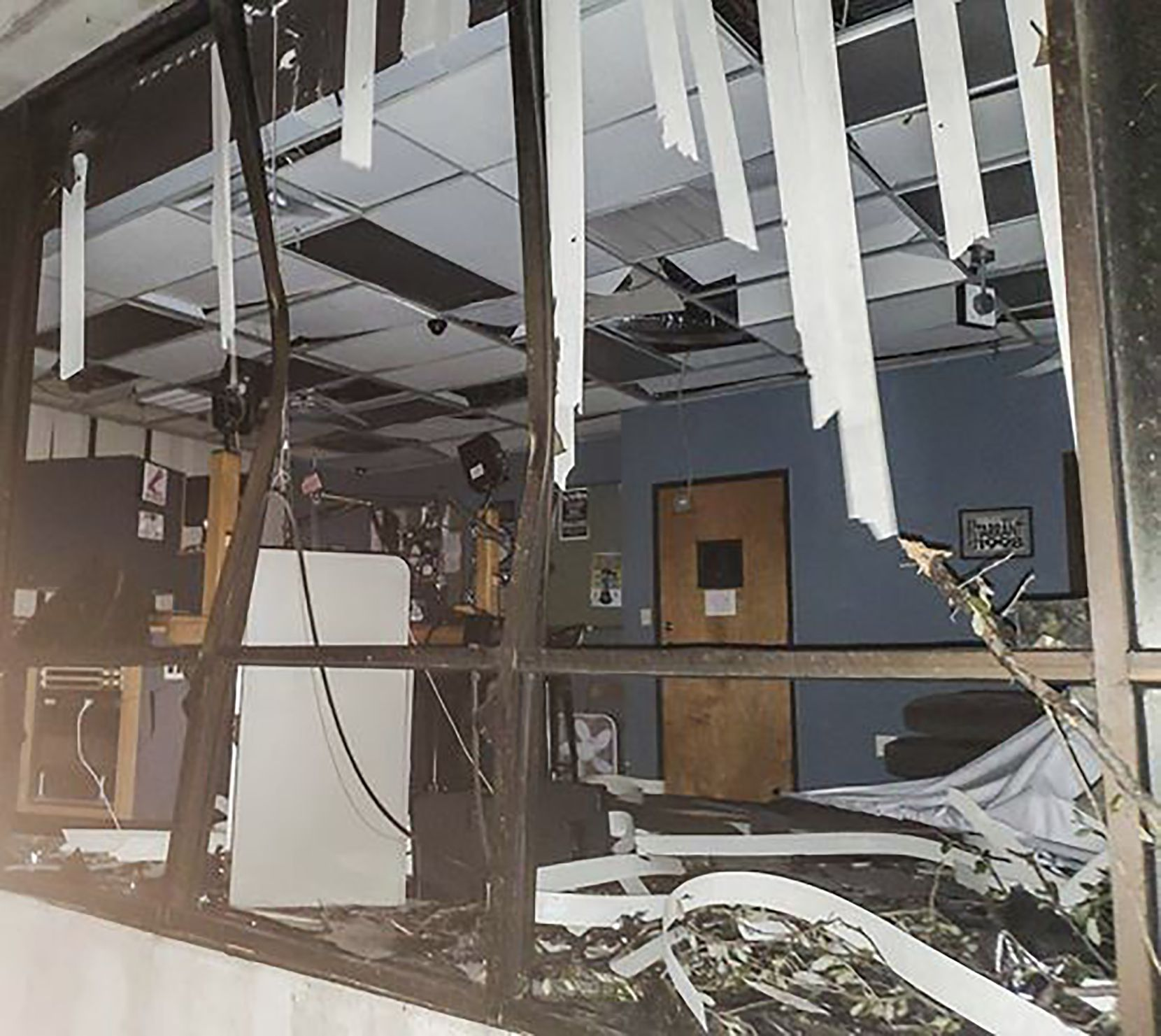 In this Sunday, Oct. 20, 2019 photo offered by Lew Morris, damage to the KNON-FM radio station studio is seen after a tornado touched down in Dallas.