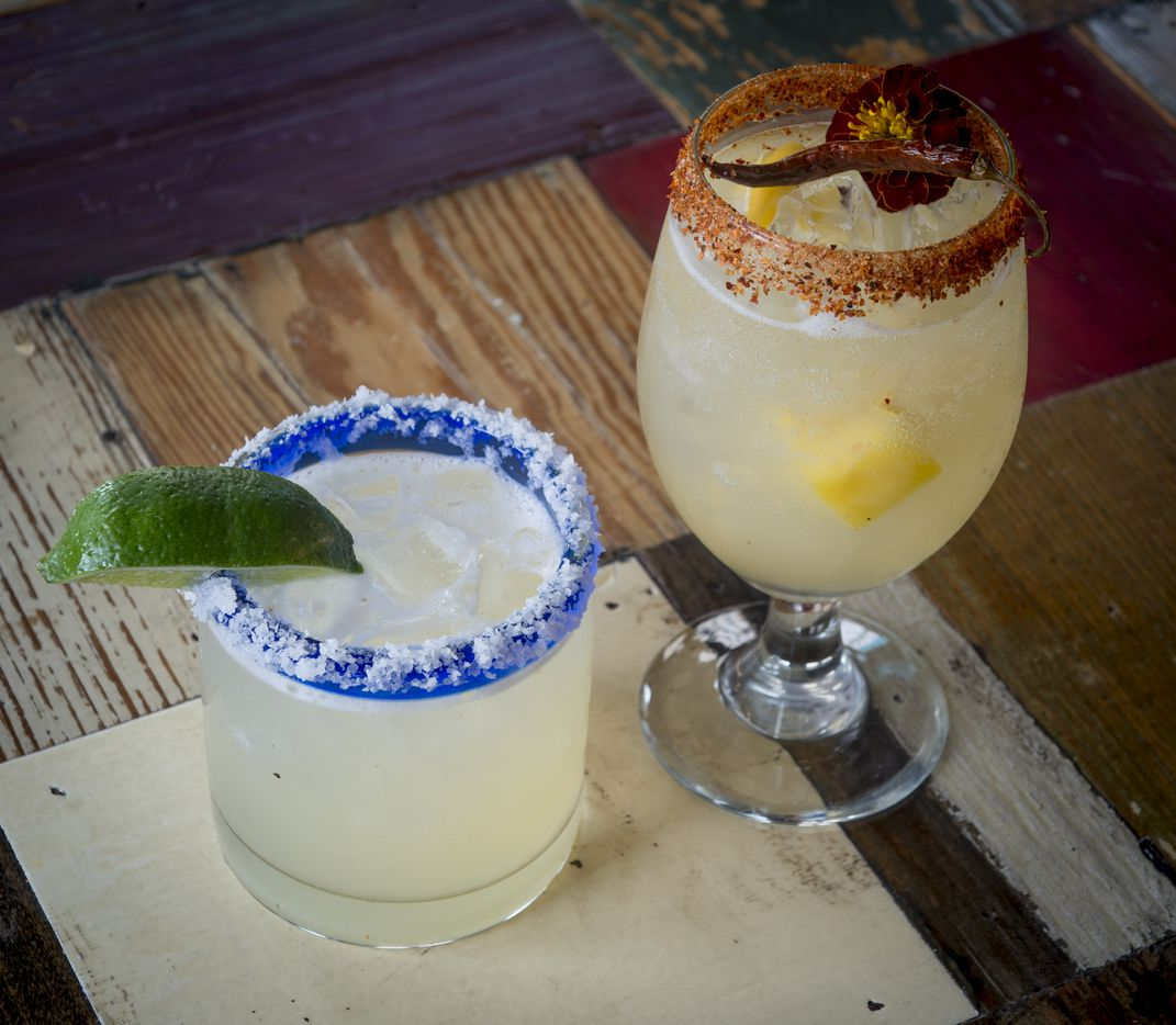 These two margaritas, the Arbol Chili Mango Margarita and the Margarita de Casa are the specials for Margarita Day at Wild Salsa. Shot on Feb. 16, 2019 in Dallas.