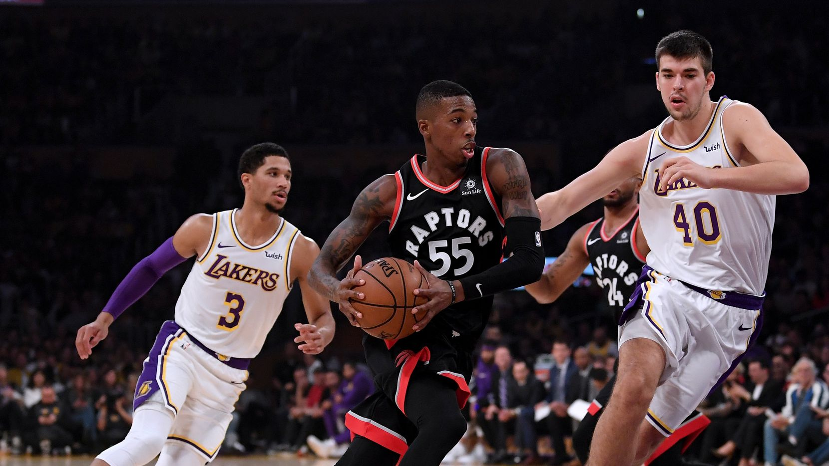 LOS ANGELES, CA - NOVEMBER 04:  Delon Wright #55 of the Toronto Raptors drives to the basket as he is chased by Ivica Zubac #40 and Josh Hart #3 of the Los Angeles Lakers at Staples Center on November 4, 2018 in Los Angeles, California.  (Photo by Harry How/Getty Images)