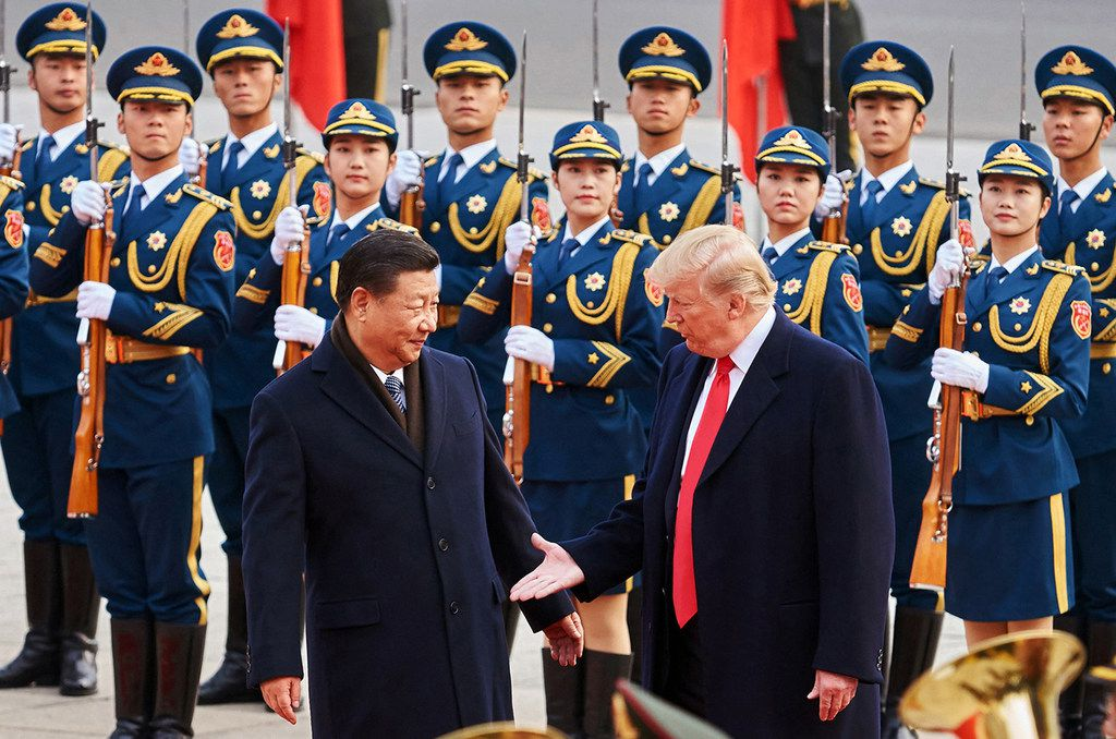 From left, China's President Xi Jinping and U.S. President Donald Trump shake hands on Nov. 9, 2017, during a meeting outside the Great Hall of the People in Beijing. (Artyom Ivanov/Tass/Abaca Press/TNS)