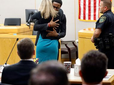 Brandt Jean hugs Amber Guyger during his victim impact statement following her sentencing for killing his older brother Botham Jean.