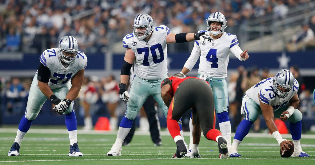 Dallas Cowboys offensive guard Zack Martin (70) points out a player before the snap as he looks toward Dallas Cowboys offensive tackle La'el Collins (71) and Dallas Cowboys quarterback Dak Prescott (4) prepares to hike the ball during the second half of play at AT&T Stadium in Arlington on Sunday, December 23, 2018. Dallas Cowboys defeated the Tampa Bay Buccaneers 27-20 to capture the NFC East. (Vernon Bryant/The Dallas Morning News)