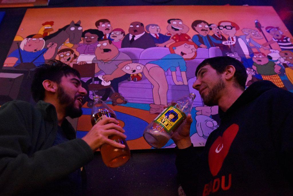 Nick Vasquez, 25, and Bob Warke, 40, drink 40 oz beers near Family Guy art work inside the pop-up bar the Drunken Clam, Thursday night Jan. 10, 2019 in Dallas. Drunken Clam is themed after the bar in Family Guy. Ben Torres/Special Contributor