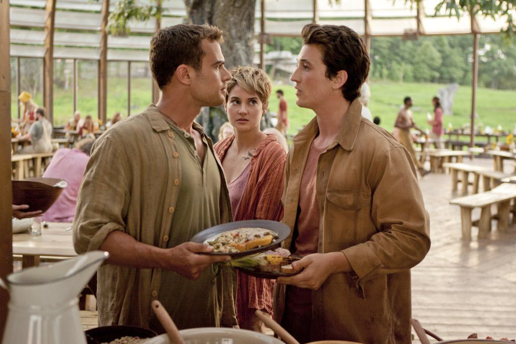 """In this image released by Lionsgate, Theo James, from left, Shailene Woodley and Miles Teller appear in a scene from """"The Divergent Series: Insurgent."""""""