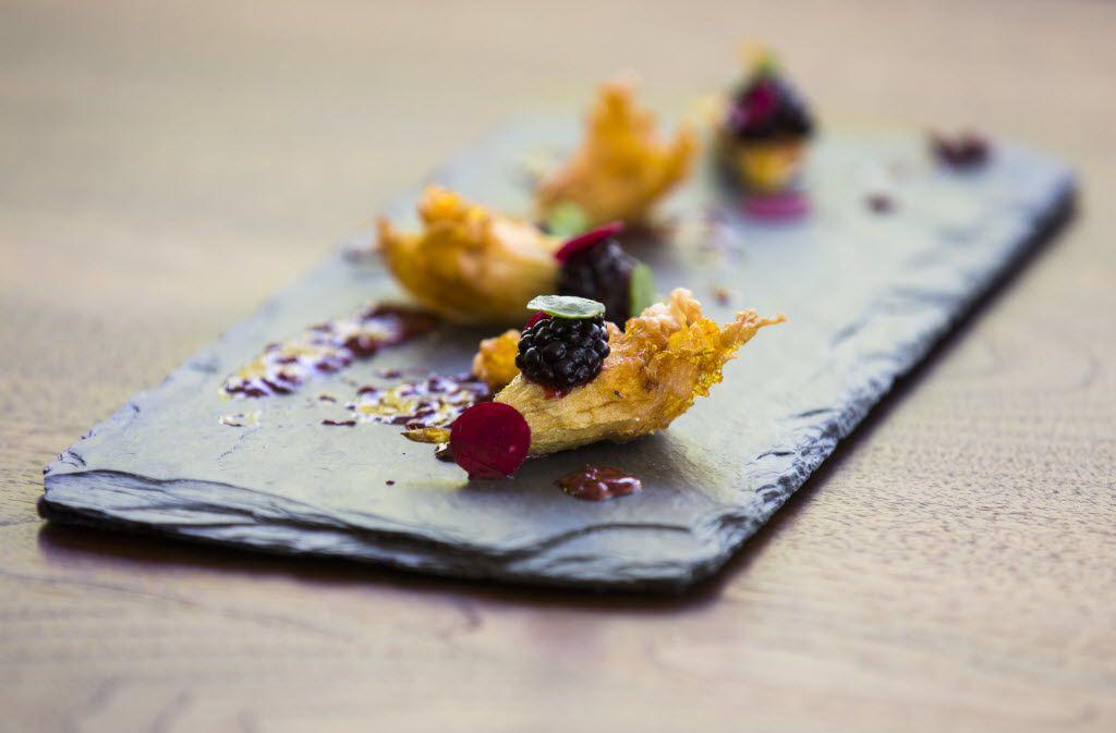 Pheasant stuffed squash blossoms with blackberry mojo and blackberries from the bar menu at Flora Street Cafe