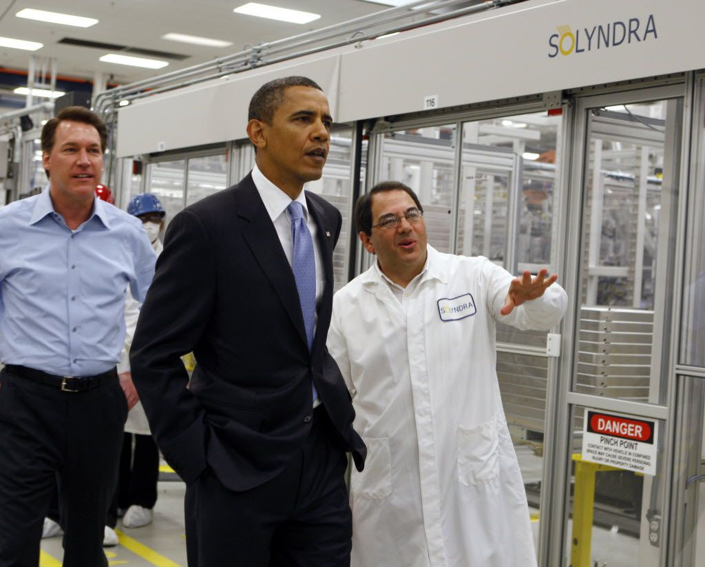 In this May 26, 2010 file photo, President Barack Obama is given a tour of Solyndra by Executive Vice President Ben Bierman, right, as Chief Executive Officer Chris Gronet (left) walks along at Solyndra Inc. in Fremont, Calif.