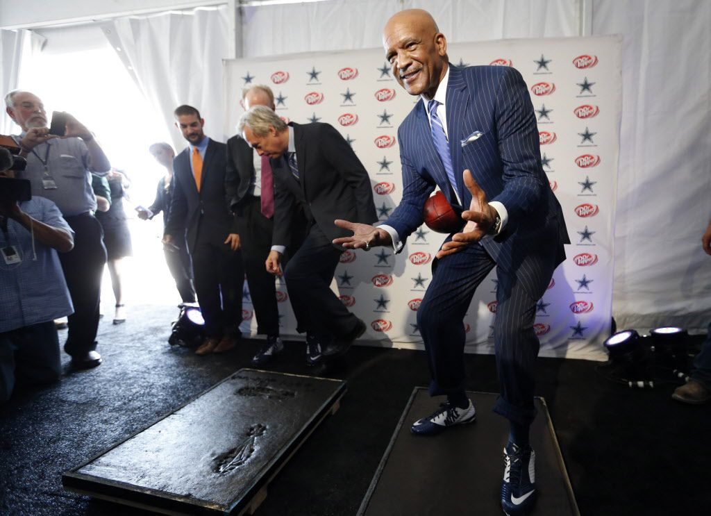 """Dallas Cowboys Drew Pearson assumes the position from the """"Hail Mary,"""" catch while standing in cement during a press conference announcing the retail aspect at the Dallas Cowboys new headquarters at The Star in Frisco, on Wednesday, May 4, 2016. This will be placed in the Dallas Cowboys Ring of Honor Walk. Roger Staubach's imprint will be placed 50 yards apart from Pearson's paying homage to the 50 yard """"Hail Mary,"""" pass in the 1975 Minnesota Vikings playoff game. The Star a joint project with the City of Frisco is scheduled to open in August. (Vernon Bryant/The Dallas Morning News)"""