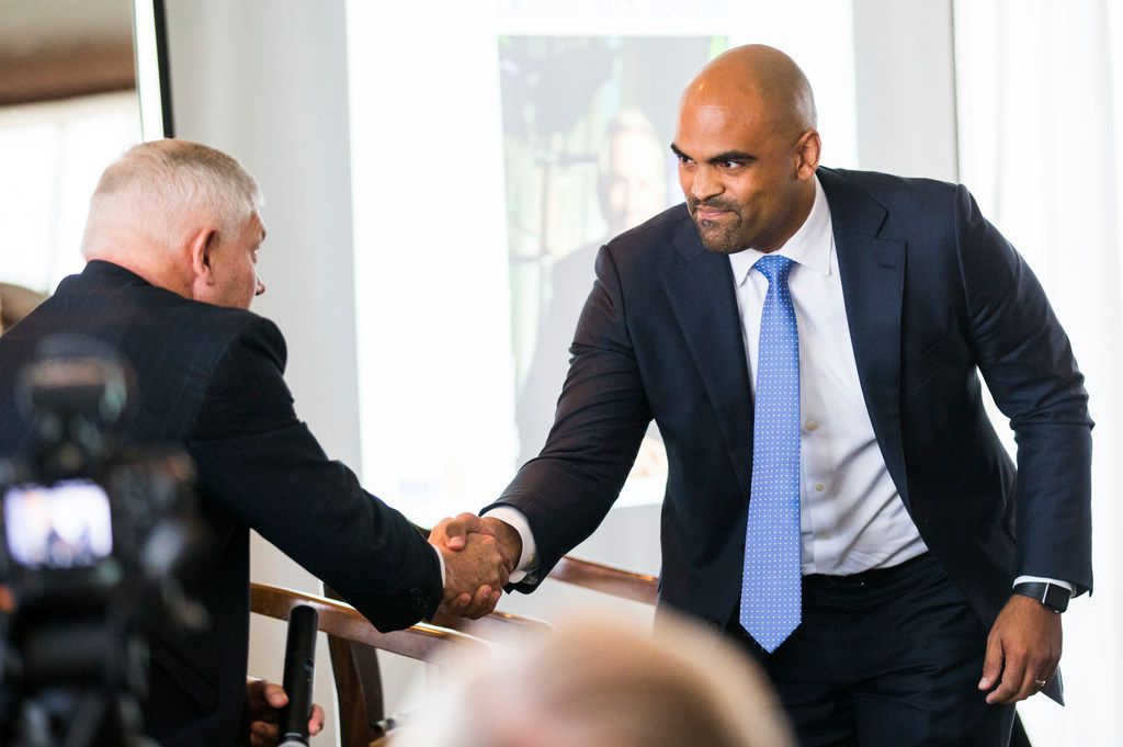 Congressional candidates Colin Allred and Pete Sessions shake hands before a debate at a Rotary Club of Dallas lunch on Wednesday, September 19, 2018 at The City Club in downtown Dallas. (Ashley Landis/The Dallas Morning News)
