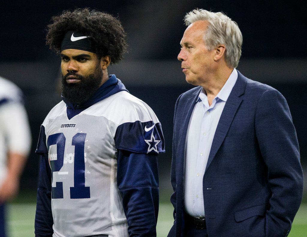 Dallas Cowboys running back Ezekiel Elliott (21) talks with Rich Dalrymple, senior vice president of public relations and communications, during a Dallas Cowboys OTA practice on Wednesday, May 22, 2019 at The Star in Frisco. (Ashley Landis/The Dallas Morning News)