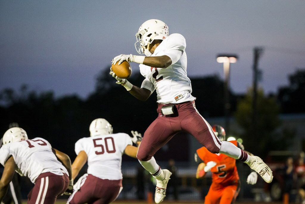 Plano running back Brandon Stephens (2) makes a leaping catch during the first half of a high school football game against Irving MacArthur at Irving Schools Stadium on Thursday, Sept. 3, 2015, in Irving. (Smiley N. Pool/The Dallas Morning News)