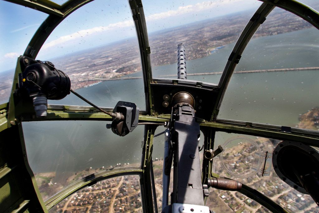 The view looking over a .30-caliber machine gun from the bombardier/navigator seat in the front nose of a North American B-25 Mitchell Bomber as the plane flies over Lake Ray Hubbard during a media flight on Wednesday, March 13, 2019. The bomber is part of Collins Foundation's Wings of Freedom Tour at the Frontiers of Flight Museum.