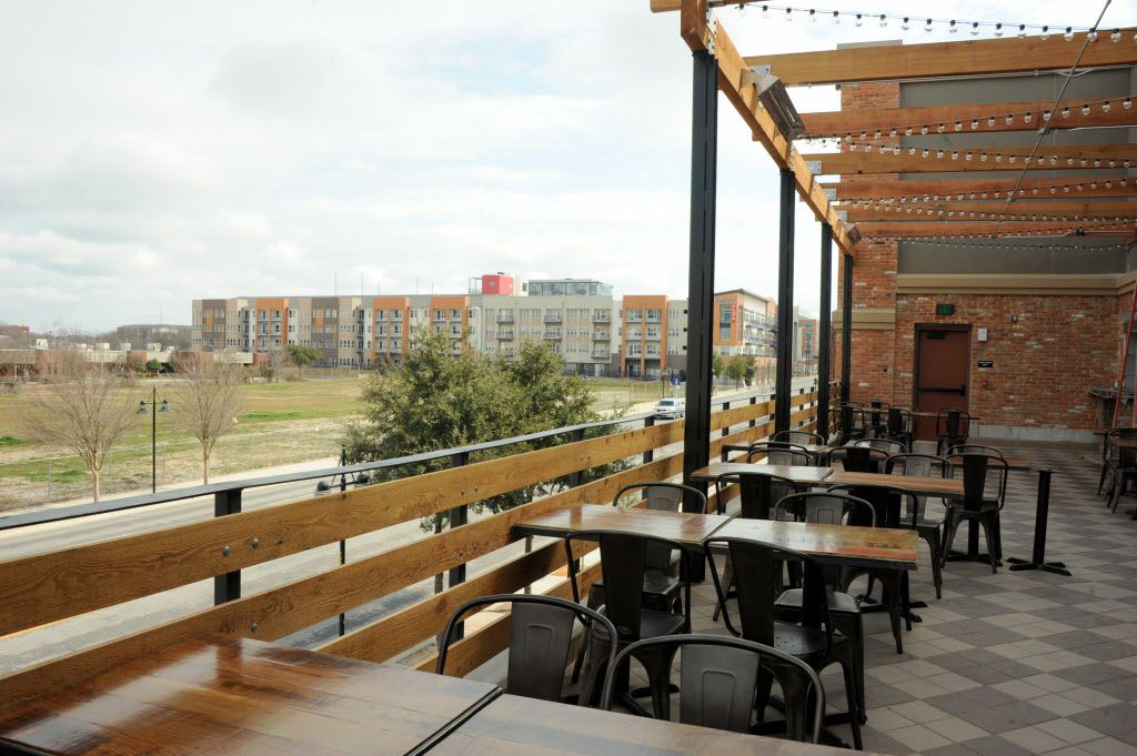 The large patio extended from Vetted Well features views of downtown Dallas.