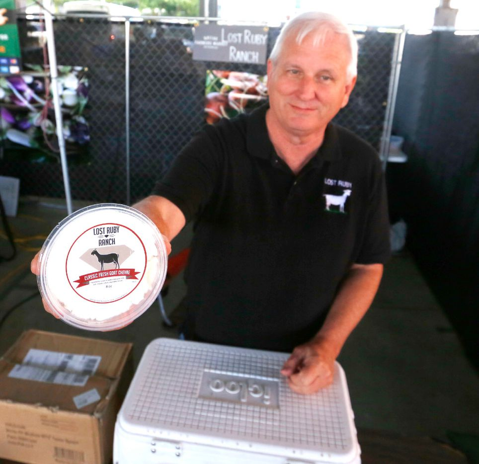 Paul Allen, with Lost Ruby Ranch, offers goat cheese at his booth in The Shed at the Dallas Farmers Market.