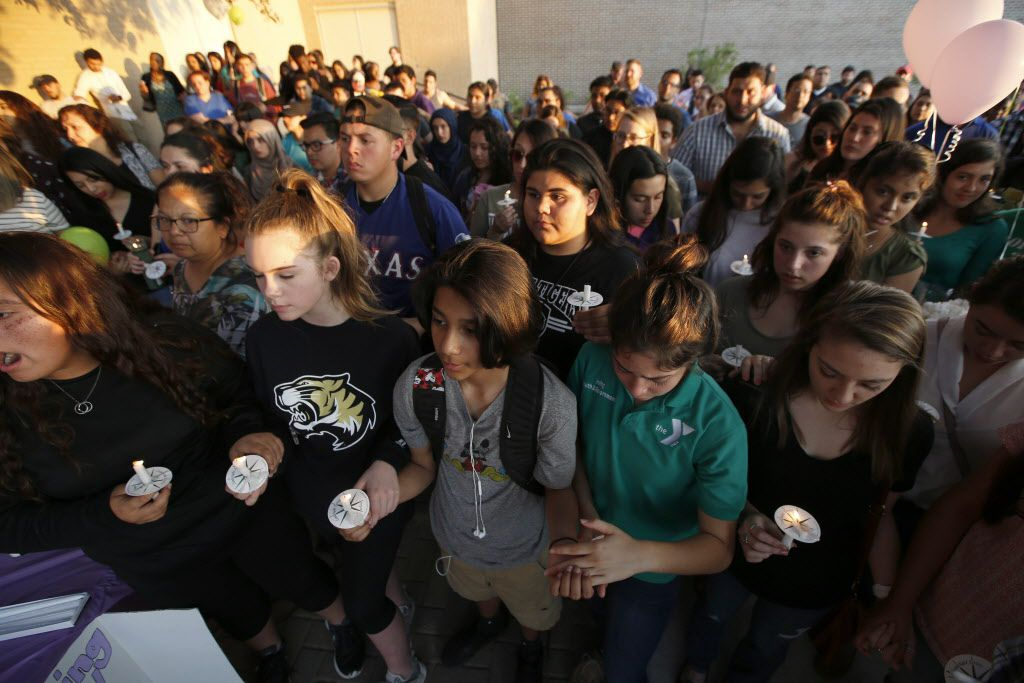 Friends gather during a memorial held for Janeera Gonzalez, the North Lake College student slain Wednesday, at Irving High School in Irving, Texas on May 8, 2017.