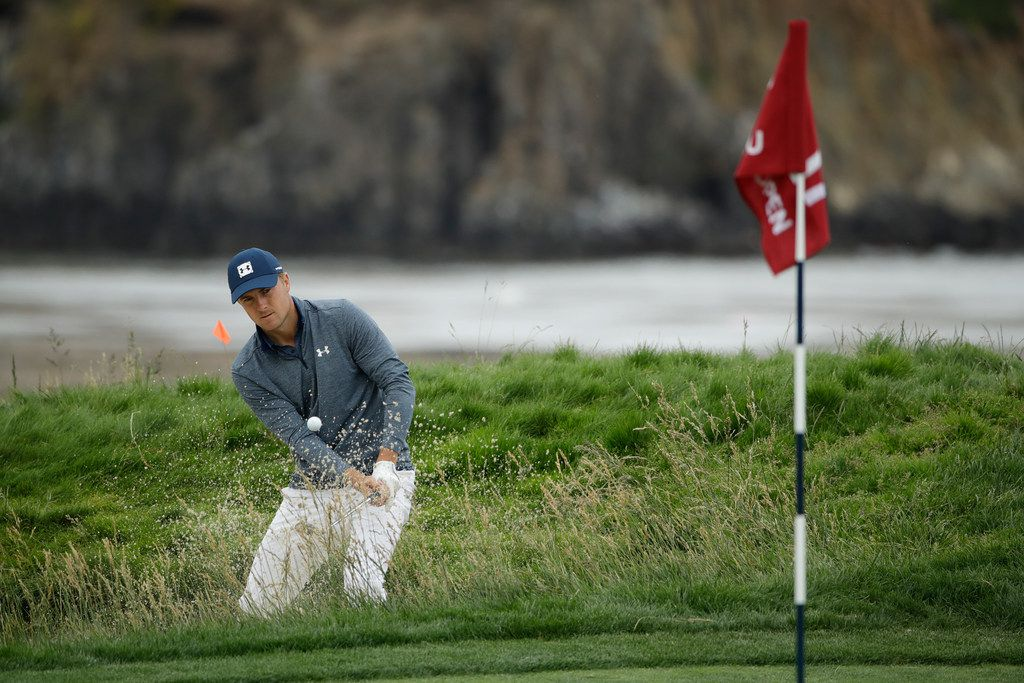 Jordan Spieth hits out of the bunker on the 17th hole during the second round of the U.S. Open Championship golf tournament Friday, June 14, 2019, in Pebble Beach, Calif. (AP Photo/Marcio Jose Sanchez)