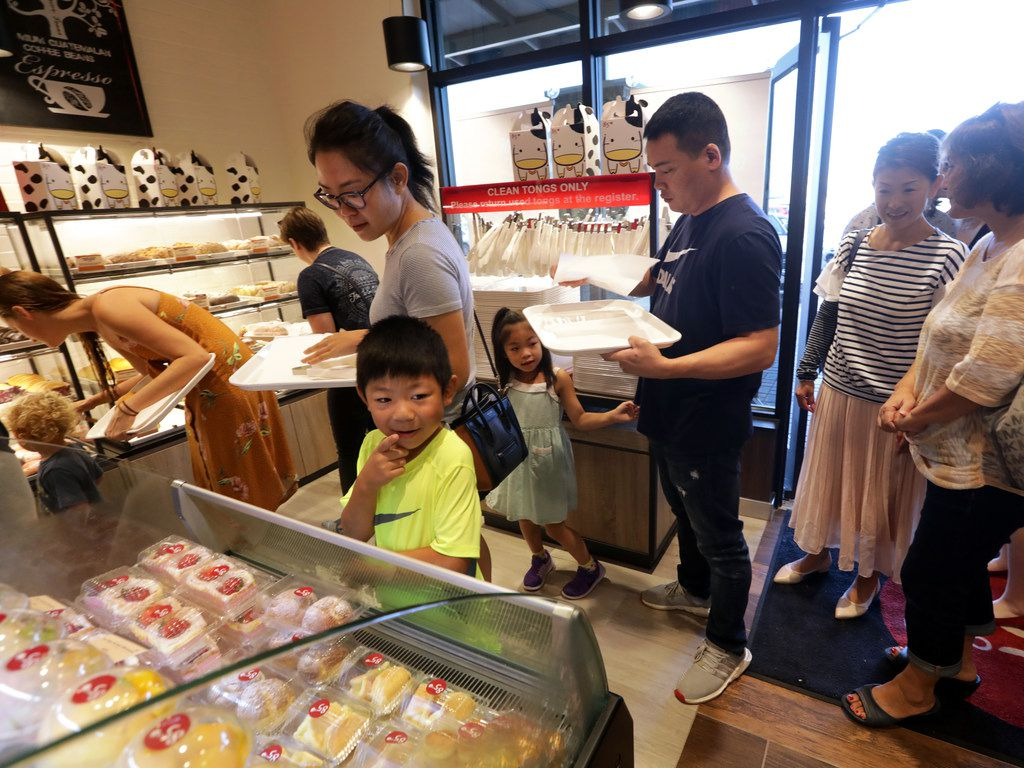 Customers celebrate the opening of 85°C Bakery Cafe in Frisco. It's the fifth 85°C Bakery and Cafe in North Texas.