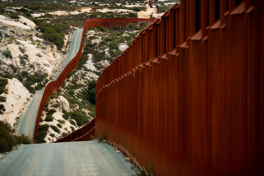 A section of the U.S.-Mexico border fence in Tecate, Calif. (Jim Watson/Agence France-Presse)
