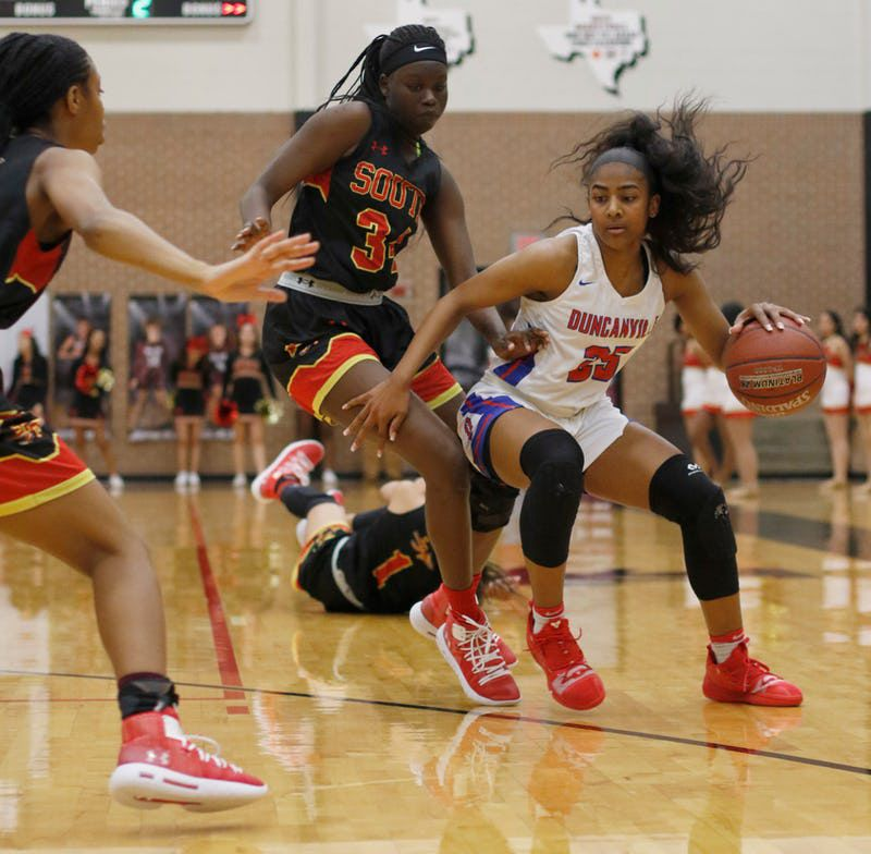 Duncanville guard Deja Kelly (25) drives to the basket as she is defended by an unidentified duo of South Grand Prairie defenders during second half action. The two teams played their Class 6A bi-district girls basketball playoff game at Mansfield Timberview High School in Arlington on February 12, 2019. (Steve Hamm/ Special Contributor)