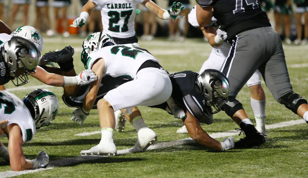 Denton Guyer's Kaedric Cobb (1) dives for a touchdown as Southlake Carroll's Josh Sweat (24) attempts to stop him during the first half of play at C.H. Collins Complex in Denton, on Friday, October 4, 2019. (Vernon Bryant/The Dallas Morning News)