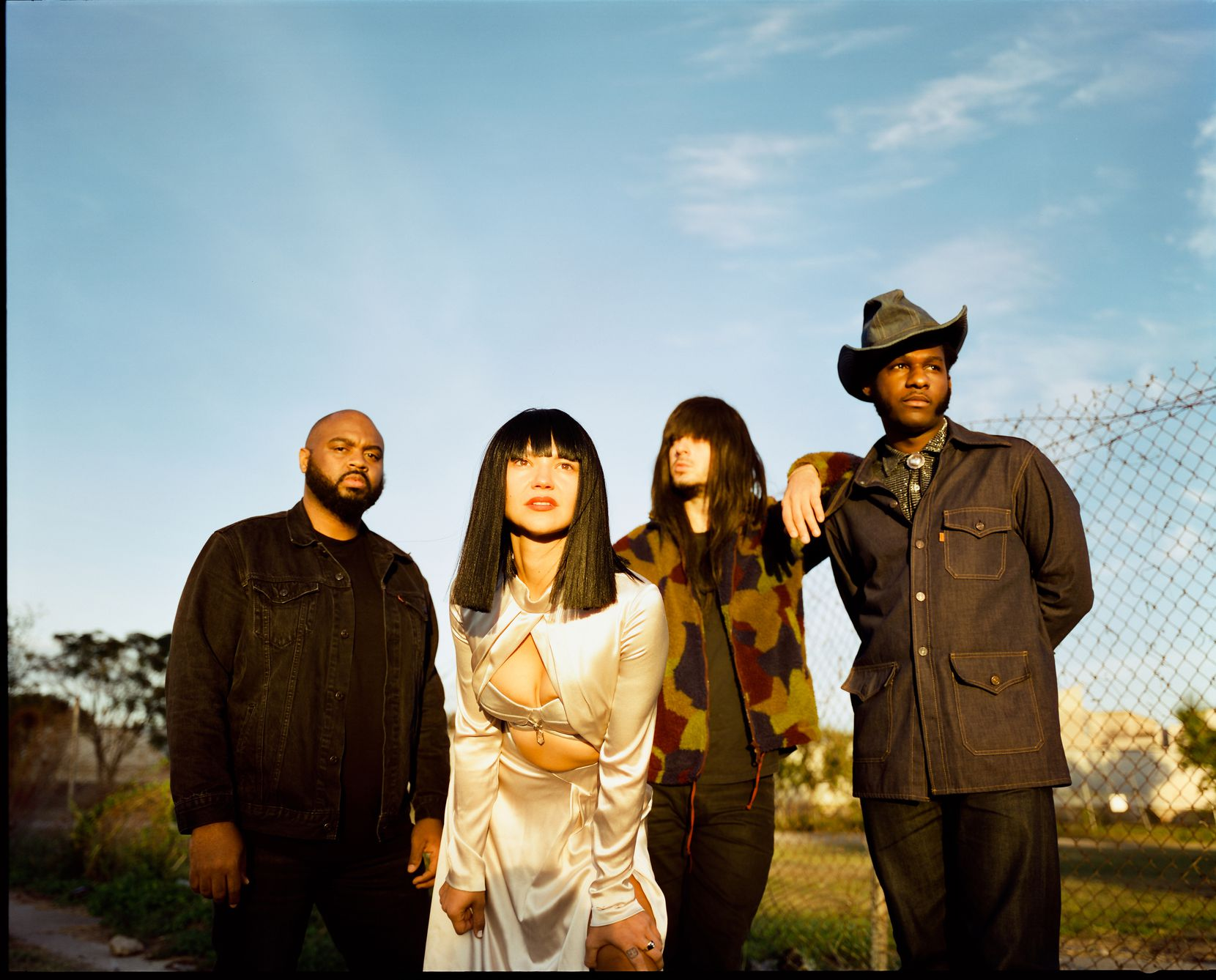 The Houston band Khruangbin poses for a publicity photo with Leon Bridges.