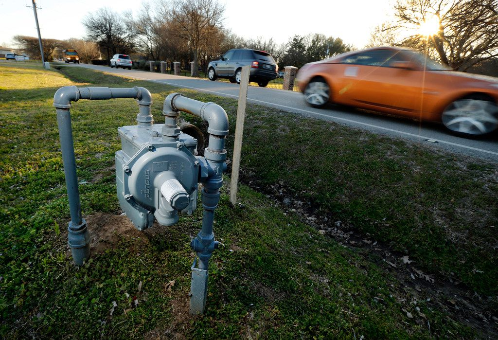 Vehicles pass a gas meter at 223 S Pearson Lane in Keller, Texas, Monday, February 25, 2019. (Tom Fox/The Dallas Morning News)