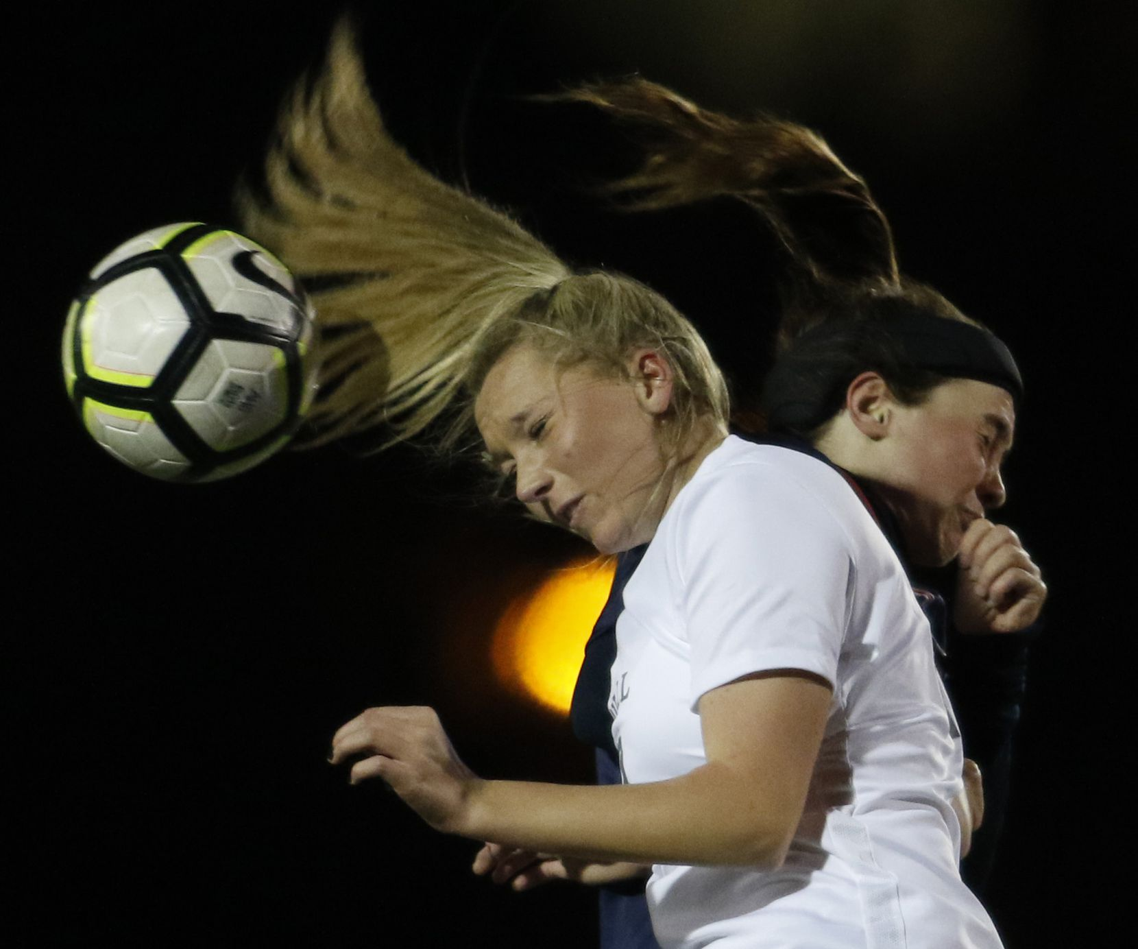 Southlake Carroll defender Lauryn Mazick (23) foreground, winces after colliding with Allen forward Anna Reysa (21) as the two leaped to head the ball to a teammate during first half action. Southlake Carroll won the defensive battle, 1-0. The two teams played their non-district girls soccer game at Colleyville High School in Colleyville on January 10, 2019. (Steve Hamm/ Special Contributor)