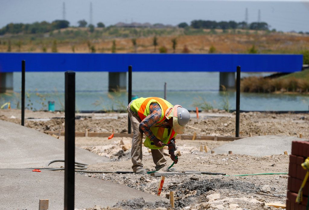 A worker during construction of the Cypress Waters development in Irving, TX on July 23, 2018. (Nathan Hunsinger/The Dallas Morning News)