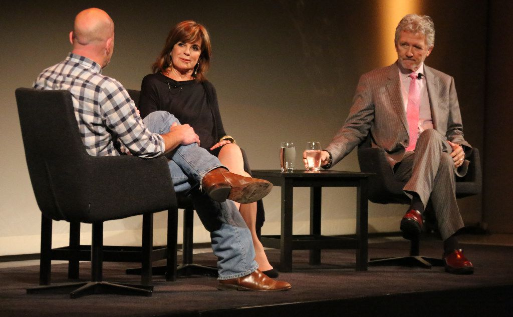 "Dallas Morning News columnist Robert Wilonsky talks with Linda Gray and Patrick Duffy at ""A Dallas Retrospective: J.R. Ewing Bourbon Presents Linda Gray and Patrick Duffy.""  (Louis DeLuca/The Dallas Morning News)"