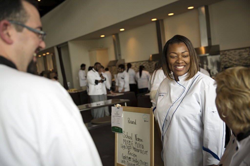 Here's how we often see Tiffany Derry: in her chef's coat, chatting with customers or coworkers.