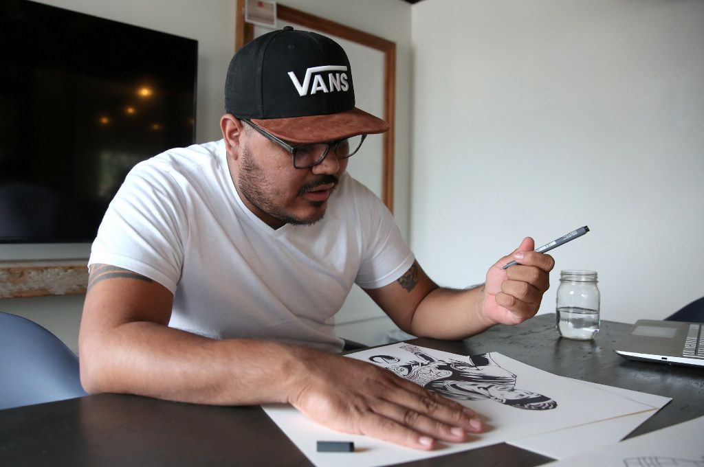 Arturo Torres, a local Dallas artist, touches up a sketch at Common Desk in the Oak Cliff neighborhood of Dallas on Thursday, May 18, 2017. (Rose Baca/The Dallas Morning News)