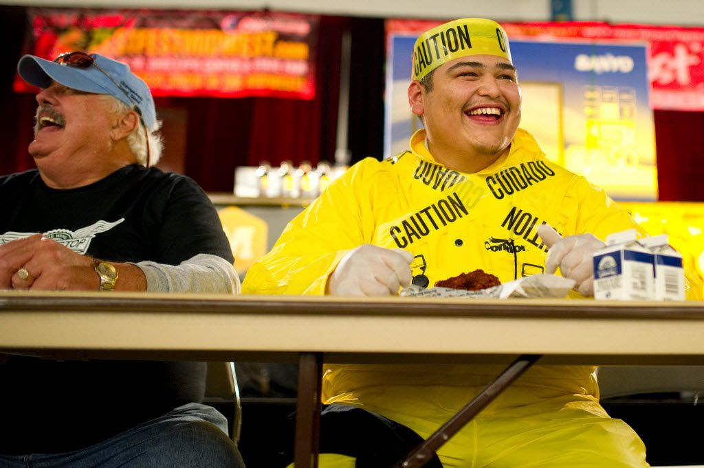 Gino Lopez competes in a wing eating contest during ZestFest at the Irving Convention Center. It's one of many food festivals in Dallas-Fort Worth.