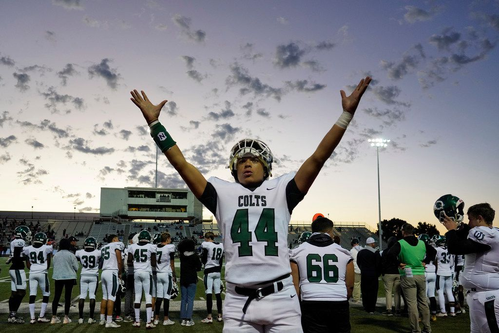 Arlington linebacker Malakhi Kellough (44) motions to the crowd during a high school football game against the Arlington Bowie at Wilemon Field on Friday, Oct. 11, 2019, in Arlington, Texas. (Smiley N. Pool/The Dallas Morning News)