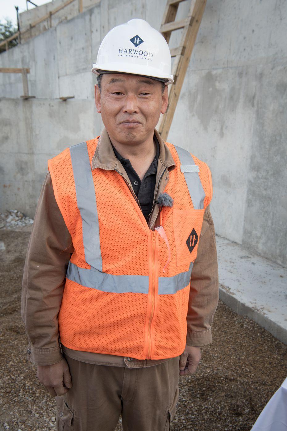 Suminori Awata is a Japanese stone mason working on the project.