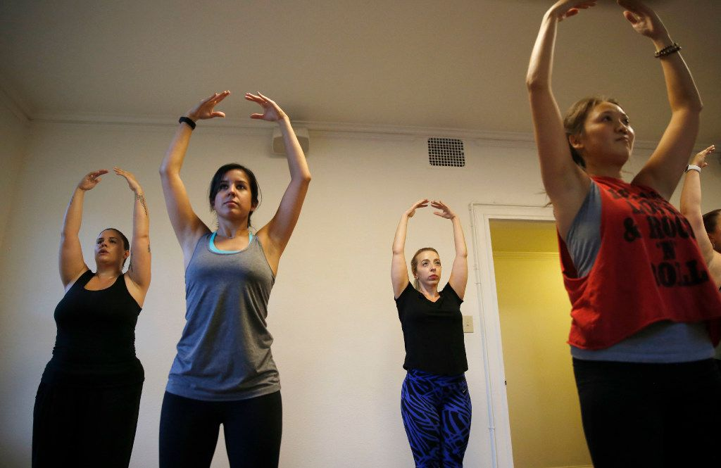 Elissa Genova (left), Rebecca Mendoza, Nazanin Fatemian and Annie Zheng of Dallas perform ballet to the music of Beyonce during a class at Arts Mission Oak Cliff.