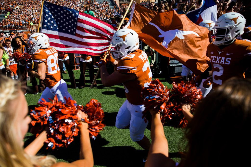 The Texas Longhorns enter the stadium before a college football game between the University of Texas and West Virginia on Saturday, November 3, 2018 at Darrell Royal Memorial Stadium in Austin, Texas. (Ashley Landis/The Dallas Morning News)